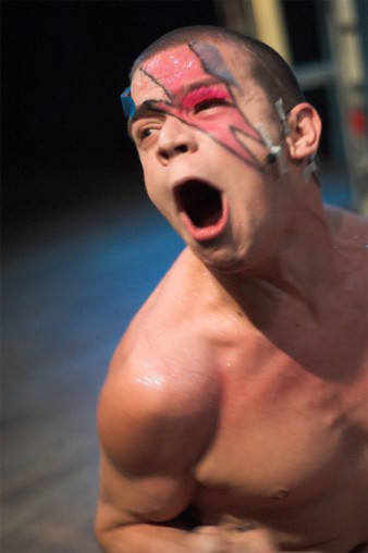 photo of male performer with streak across his face