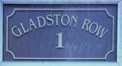 blue plaque bearing the address, 1 Gladston Row