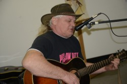 photo of Alan Holdsworth performing at the mike