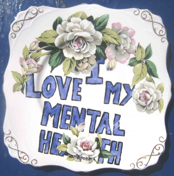 ornate plate with painted flowers and the words 'I love my mental health'