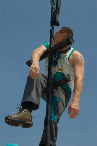 photo of performer on a tight rope against a backdrop of the sky