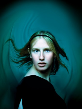 photo digital portrait of a young woman in front of a blue abstract background