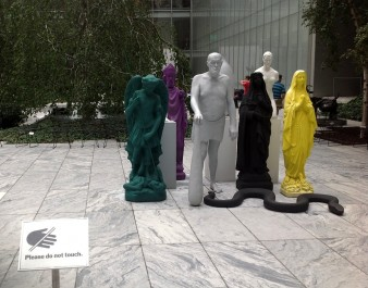 sculpture of a series of life-size figures in vivid colours in Museum of Modern Art's Sculpture Garden
