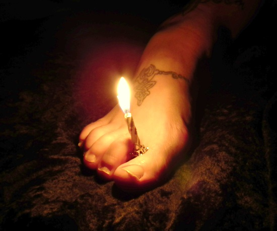 Bernadette Cremin's foot with candle