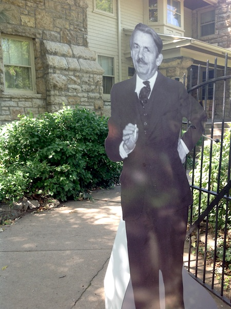 photo of lifesize cardboard cut-out of artist outside his house