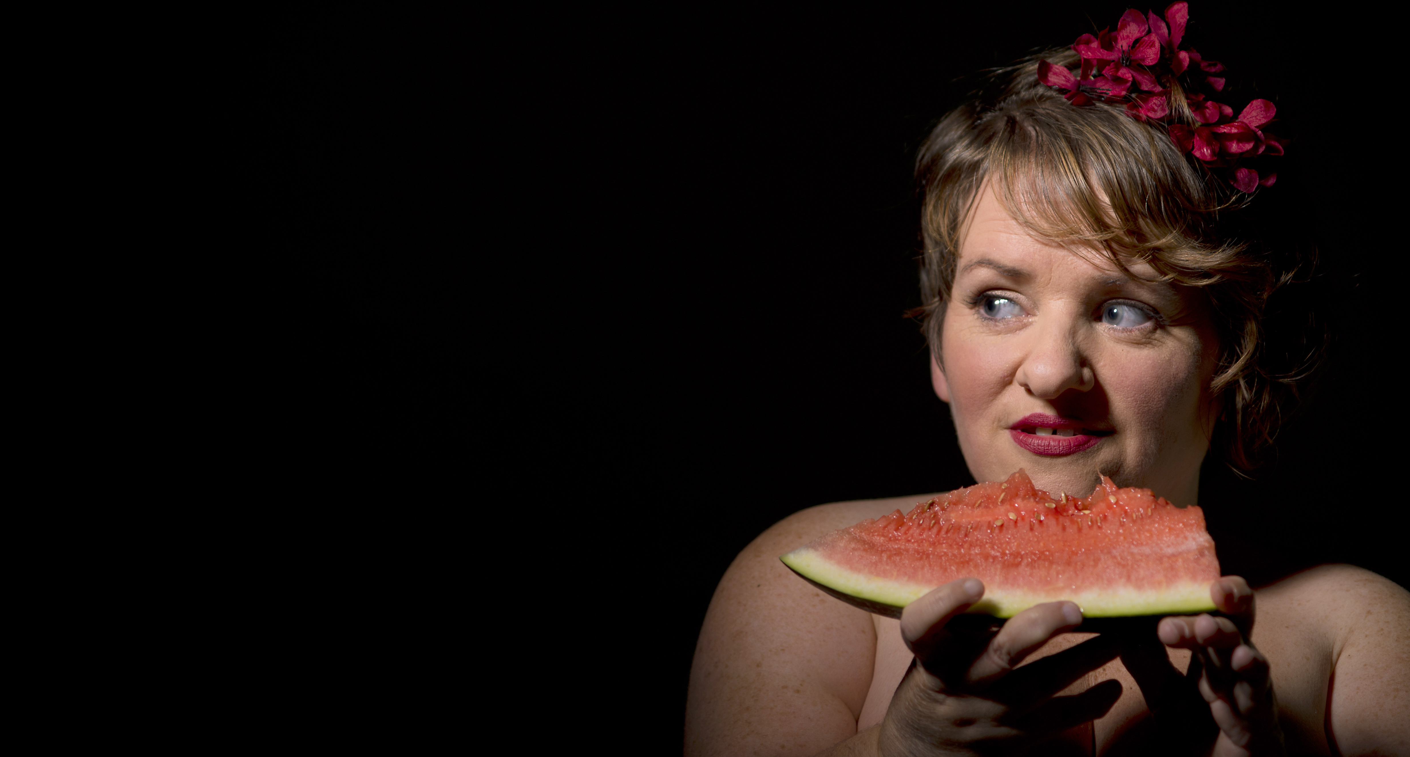 Caroline Bowditch eating a slice of watermelon